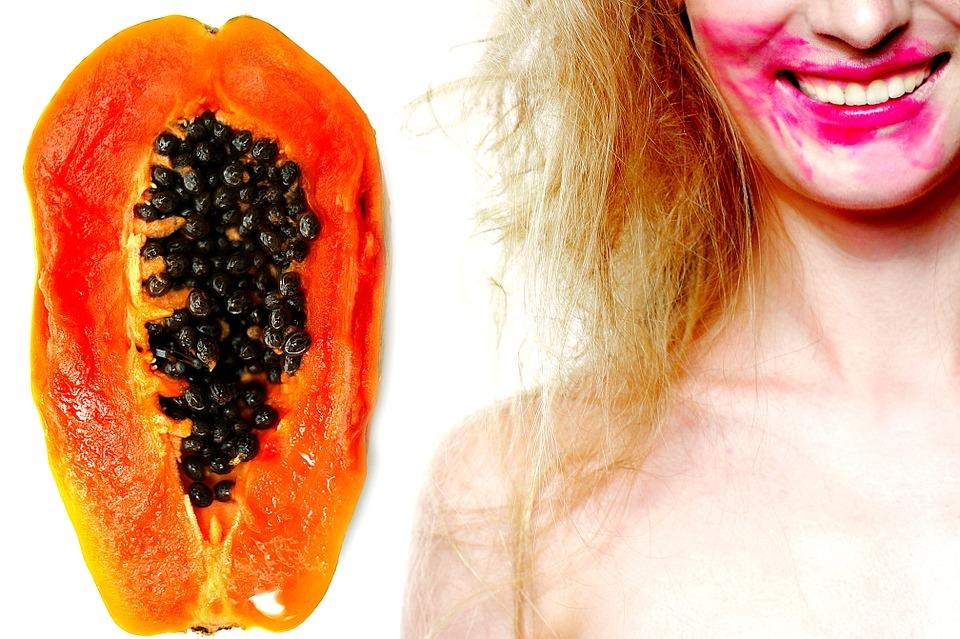 woman eating tropical fruit